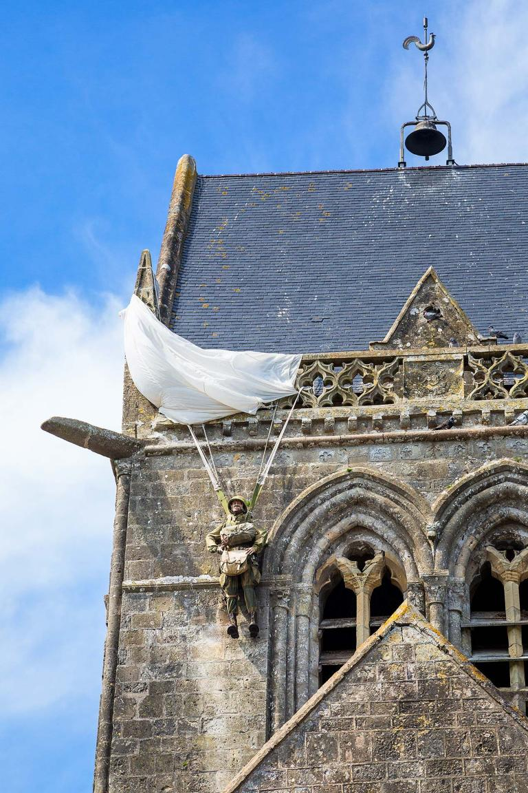 Dummy paratrooper on the church spire at Sainte Mere Eglise