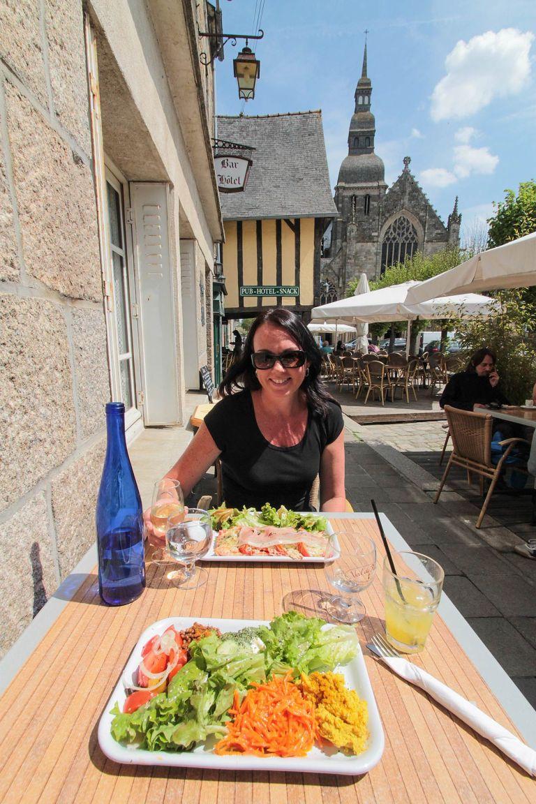 Lady enjoying salad at a French cafe in Dinan