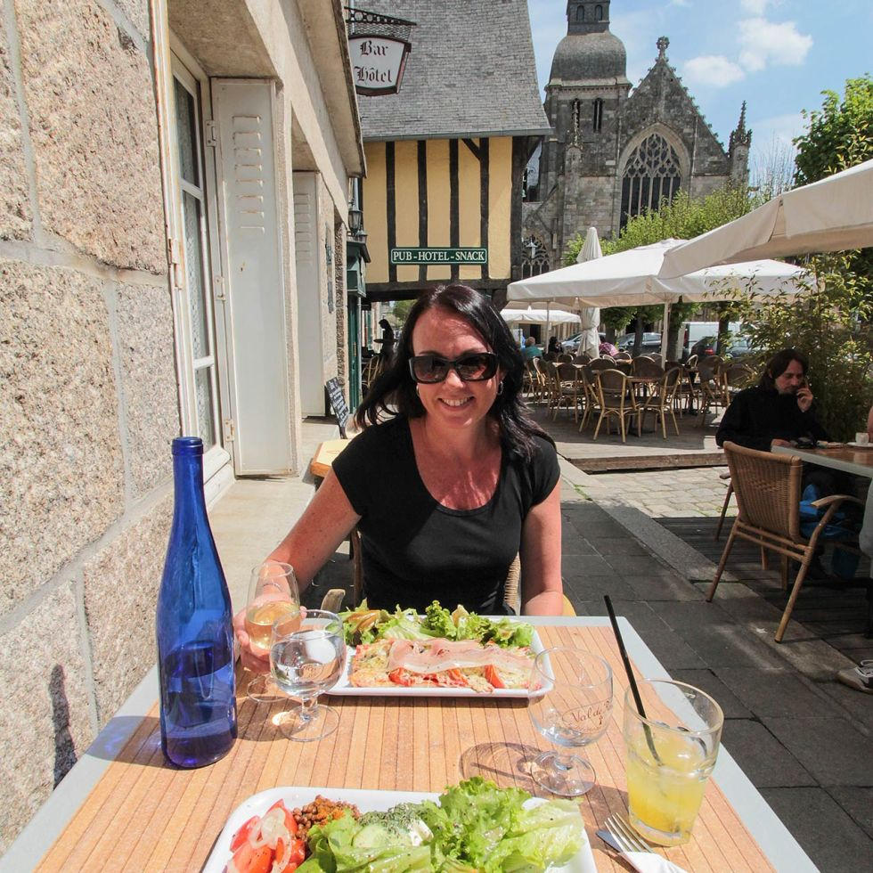 Lady enjoying salad at a French cafe in Dinan