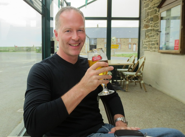 Michael Evans having a beer in Mont St Michel