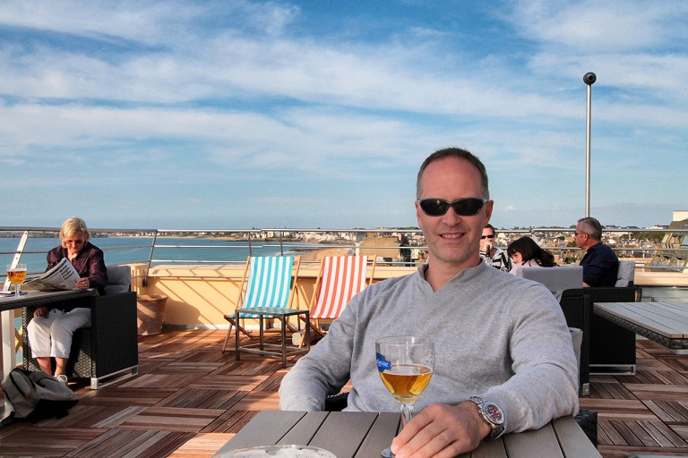 Michael Evans photographer enjoying a beer in St Malo