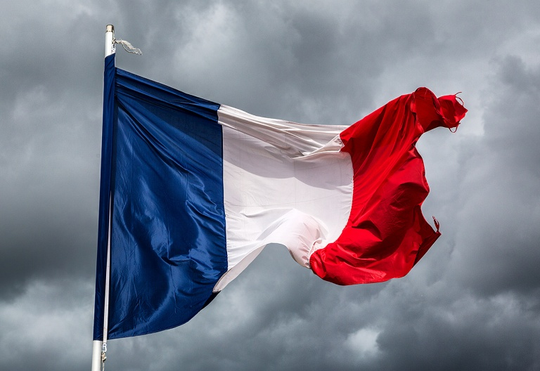 French flag against a stormy sky