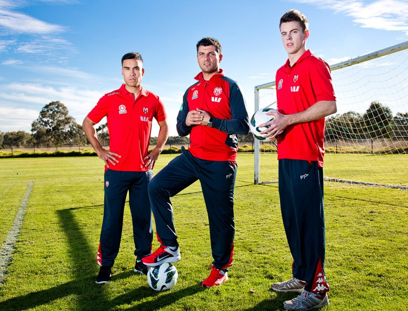 Melbourne Heart coach John Aloisi with his staff and player Iain Ramsay