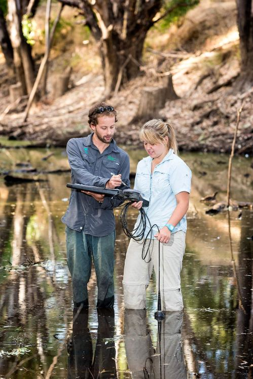 Fish research technician Kyle Weatherman and student Cassie taking water samples in bushland near Wangaratta - © Michael Evans Photographer 2014 - www.michaelevansphotographer.com