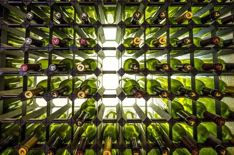 Wine bottles in a backlit wine rack - © Michael Evans Photographer 2014 - www.michaelevansphotographer.com
