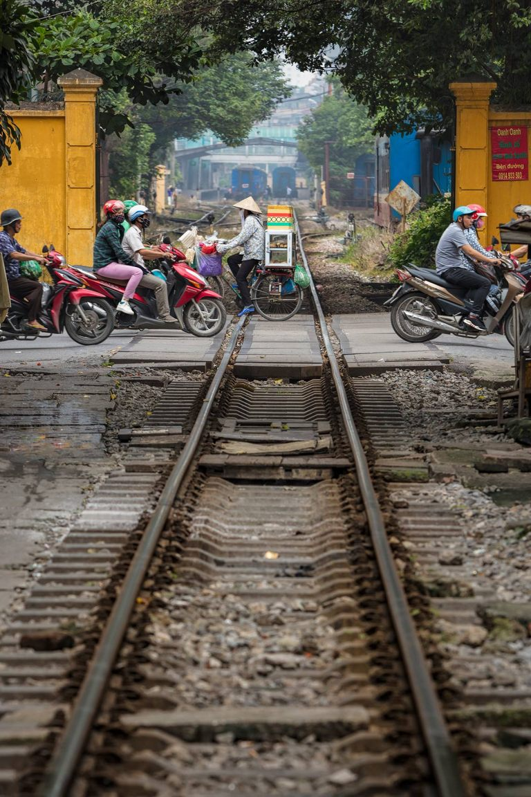 A view of the train tracks in the middle of a residential street in the Hanoi old quarter, Vietnam © Michael Evans Photographer 2019